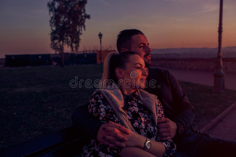 Smiling  man and woman hugging at evening the sunset royalty free stock images