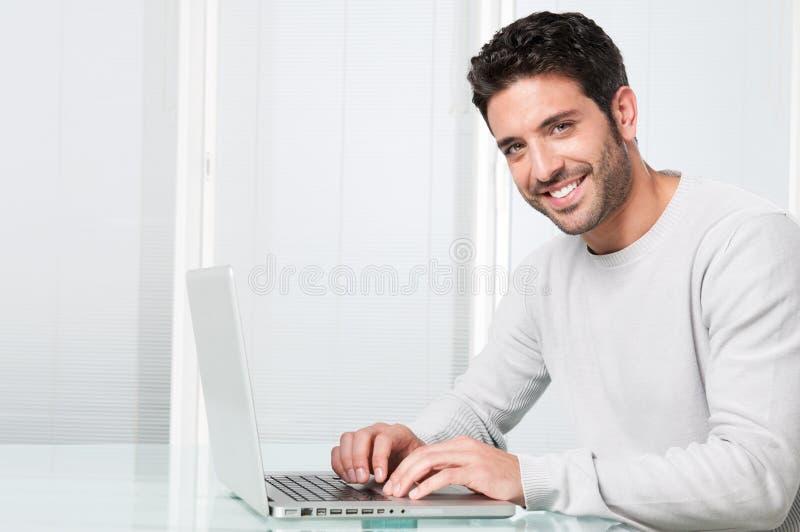 Download Smiling Man Working On Laptop Stock Image - Image: 17984301