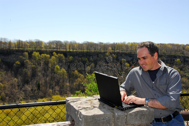 Download Smiling Man Working Outdoors Stock Image - Image of outdoor, connectivity: 843003