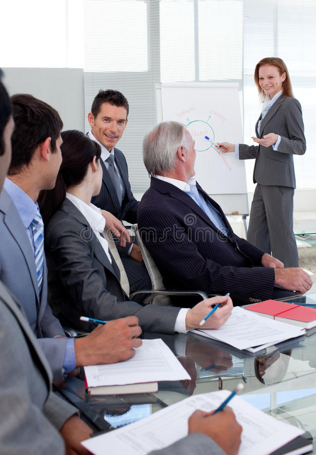 Download Smiling Manager Giving A Presentation To Her Team Stock Image - Image: 12054271
