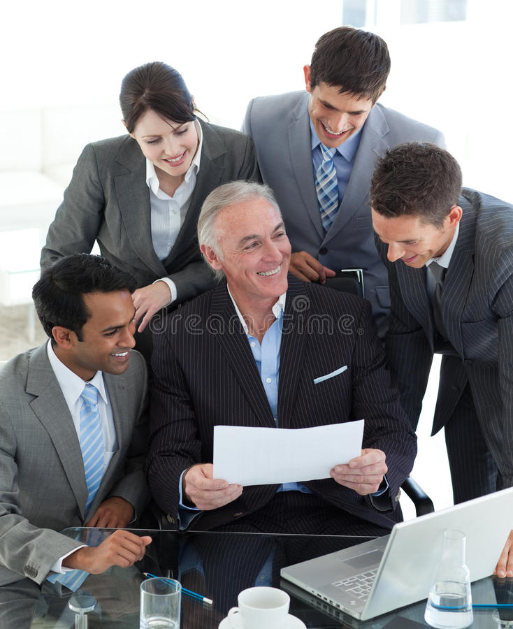 Download Smiling Manager Pointing At A Contract Stock Image - Image: 12119241