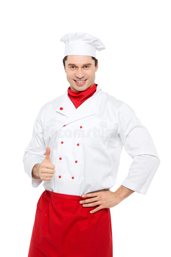 Smiling master chef showing thumb up standing isolated. Smiling master chef showing thumb up standing isolated on a white background royalty free stock images