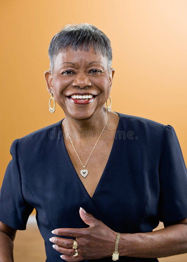 Smiling mature African woman with short hair stock photography