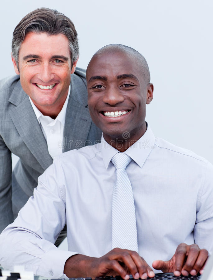 Download Smiling Mature Businessman Helping His Colleague Stock Image - Image: 12973159