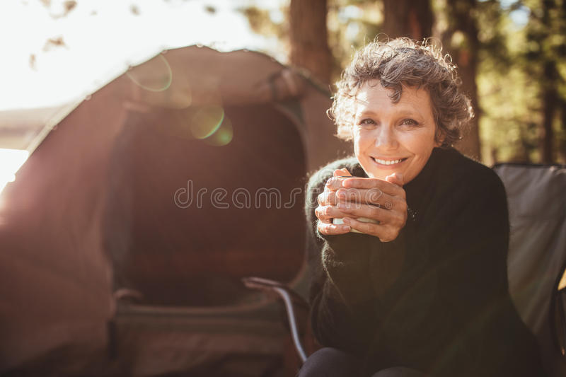 Smiling mature couple on camping royalty free stock images