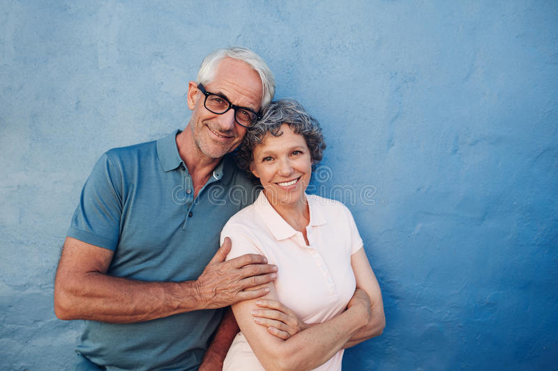 Smiling mature couple standing together royalty free stock images