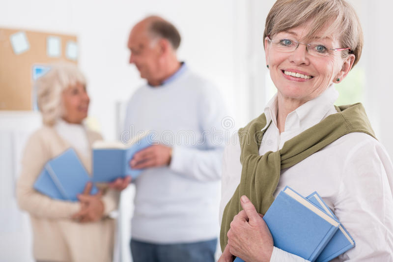 Smiling mature students stock image