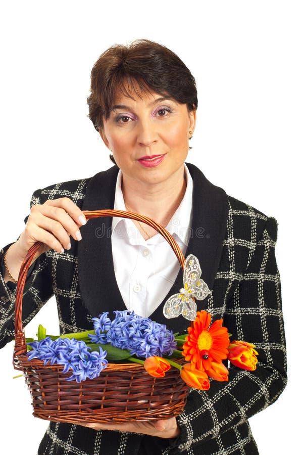 Smiling Mature Woman Holding Basket Royalty Free Stock Image