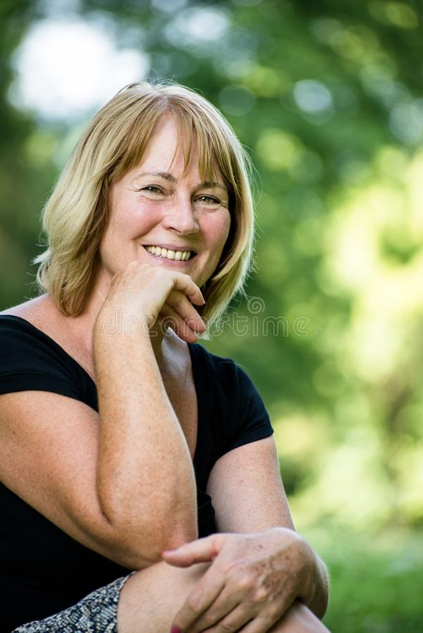 Smiling mature woman outdoor portrait royalty free stock images