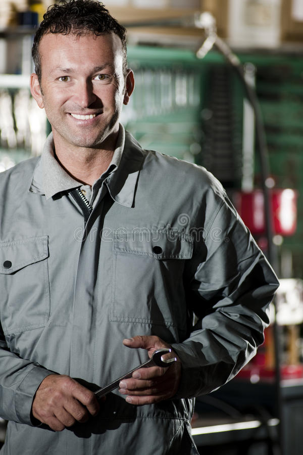 Download Smiling Mechanic stock photo. Image of moto, caucasian - 17217898