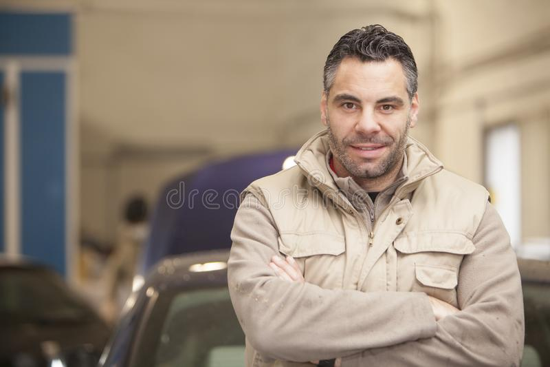 The mechanic works in the workshop stock photo