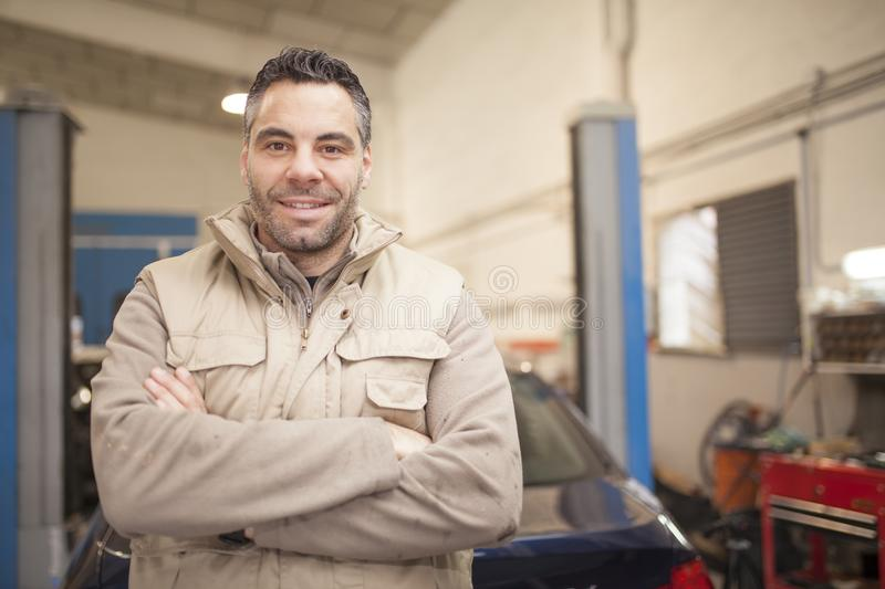 The mechanic works in the workshop royalty free stock photos