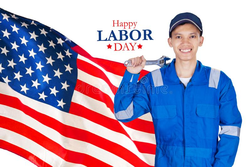 Smiling mechanic stands with Happy Labor Day text stock photos