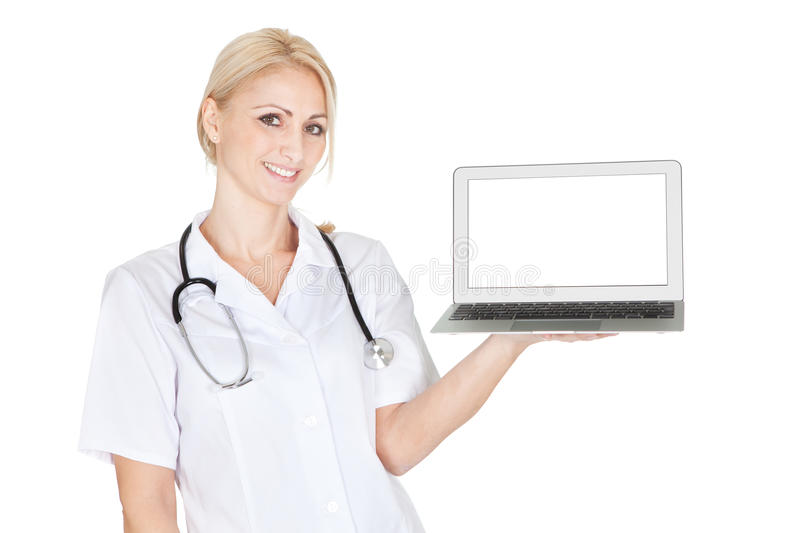 Download Smiling Medical Doctor Woman Presenting Laptop Stock Photo - Image: 23081752