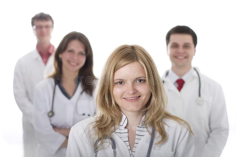 Smiling medical doctors with stethoscopes stock photo