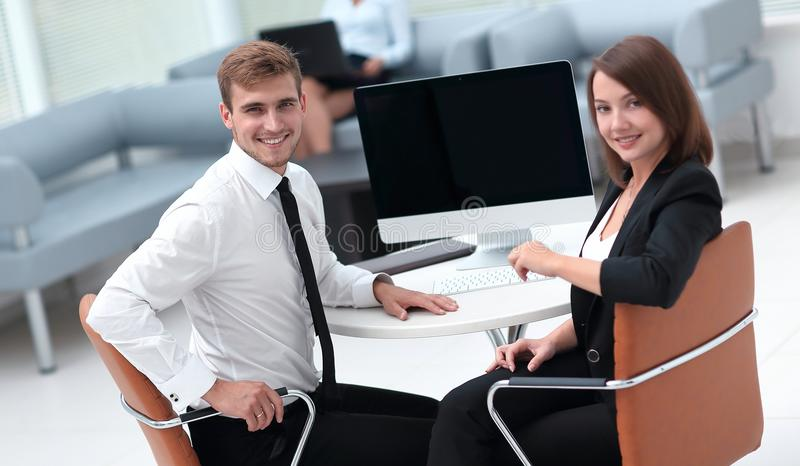 Smiling member of the business team sitting at Desk stock photos