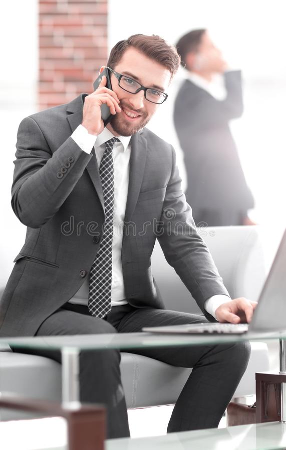Image of young businessman talking on mobile phone with clients stock photos