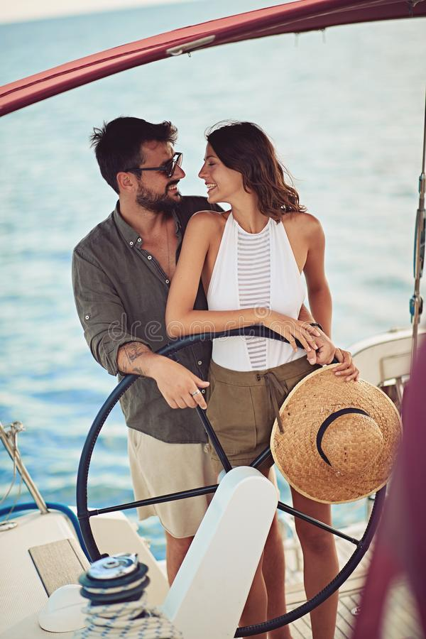 Man and woman on the boat enjoy at summer day royalty free stock images