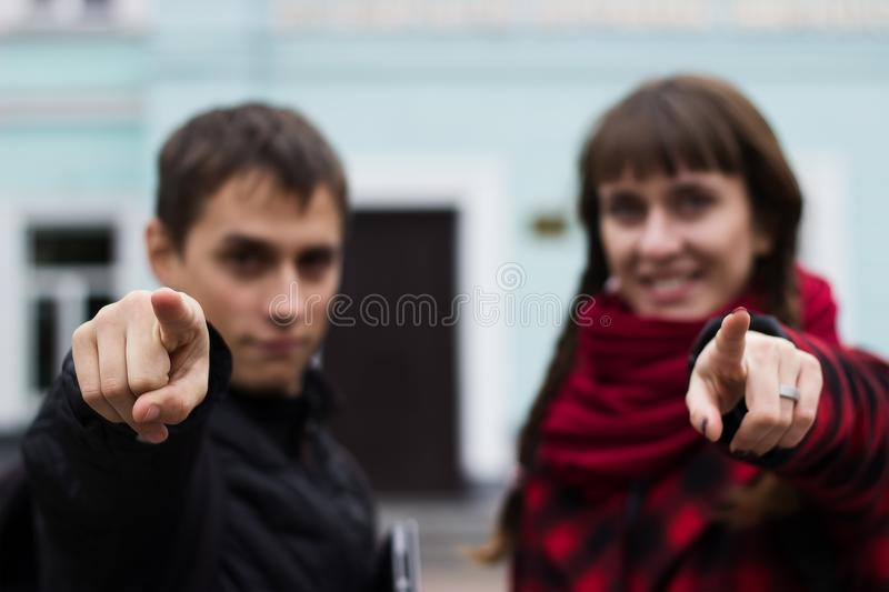 Smiling woman pointing her finger to you royalty free stock images