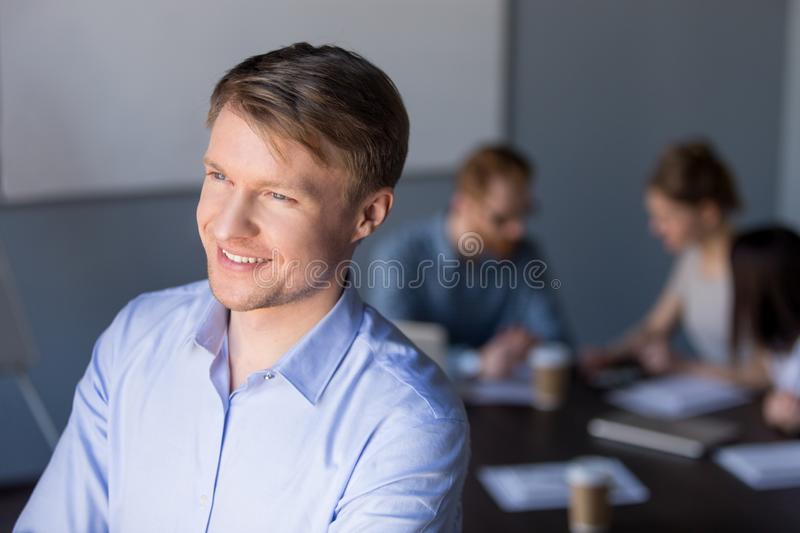 Smiling middle aged businessman looking away dreaming of future royalty free stock photo