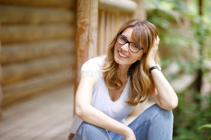 Smiling middle aged woman portait stock photography