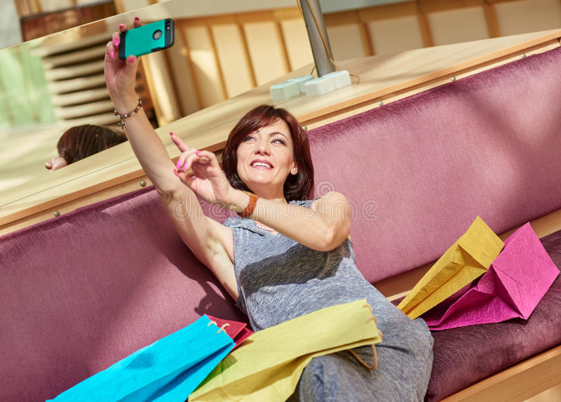 Smiling middle aged woman Taking a Selfie stock images