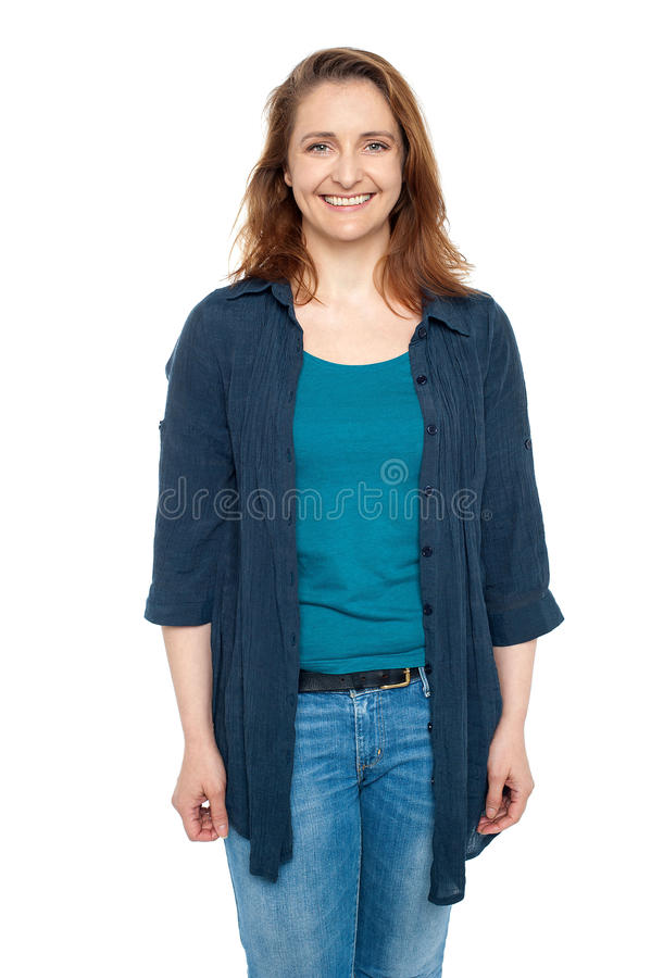 Smiling middle aged woman wearing blue cardigan royalty free stock image