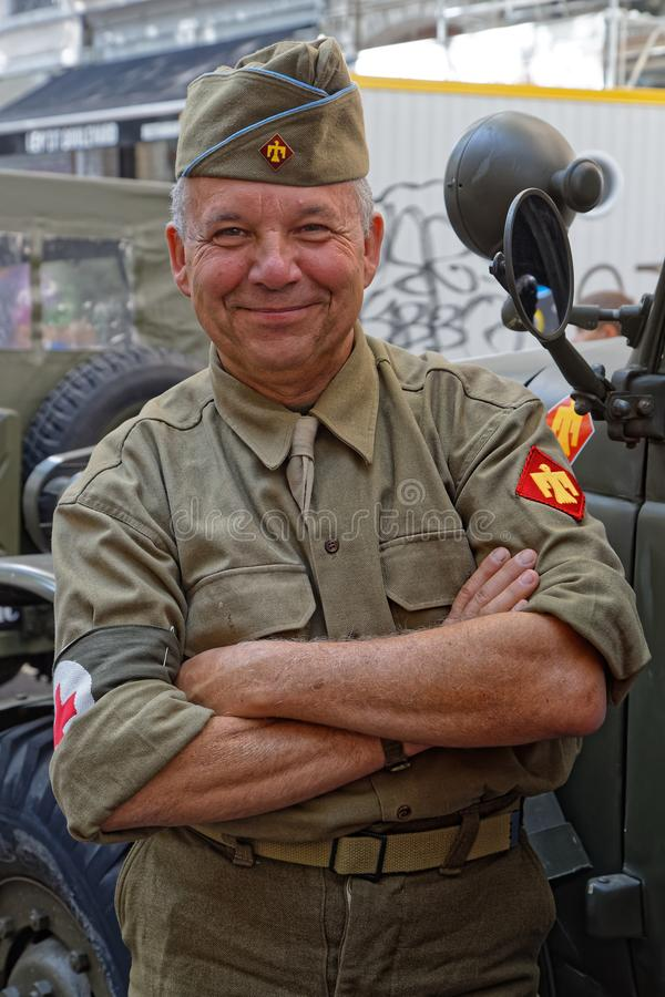 Smiling military man during 75th anniversary of Liberation of Lyon royalty free stock images
