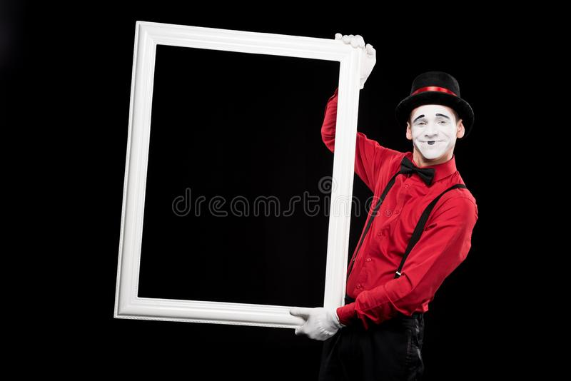 smiling mime holding frame isolated royalty free stock photo