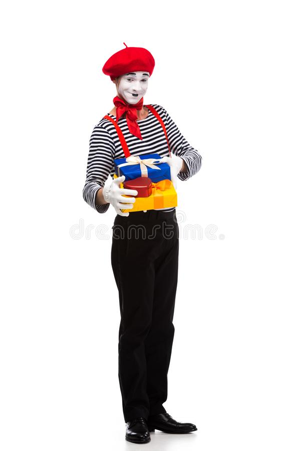 smiling mime holding gift boxes royalty free stock photo