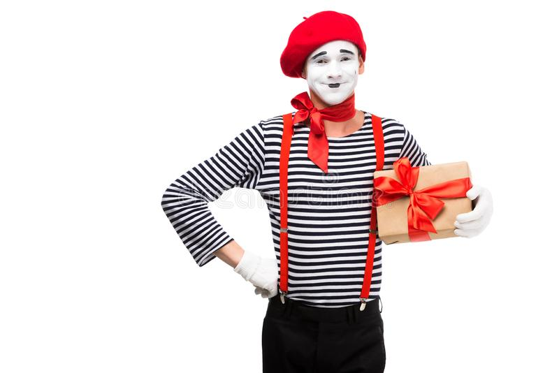 smiling mime holding present box and looking at camera royalty free stock image