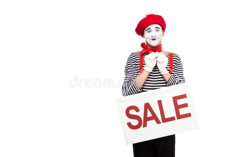 smiling mime holding sale signboard stock image