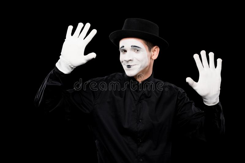 smiling mime performing and touching something stock image