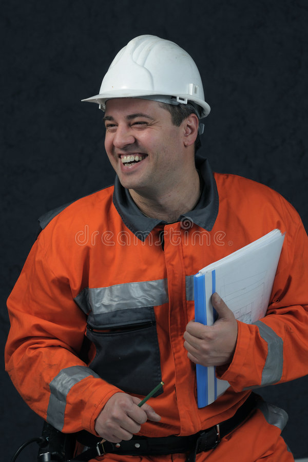 Smiling mine worker with file royalty free stock image