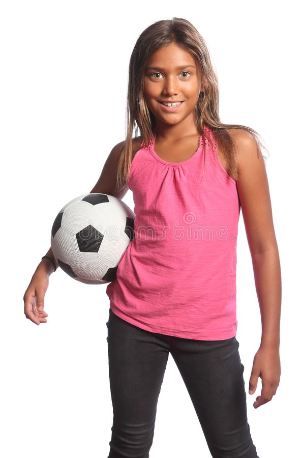 Smiling mixed race school girl holding football royalty free stock photos