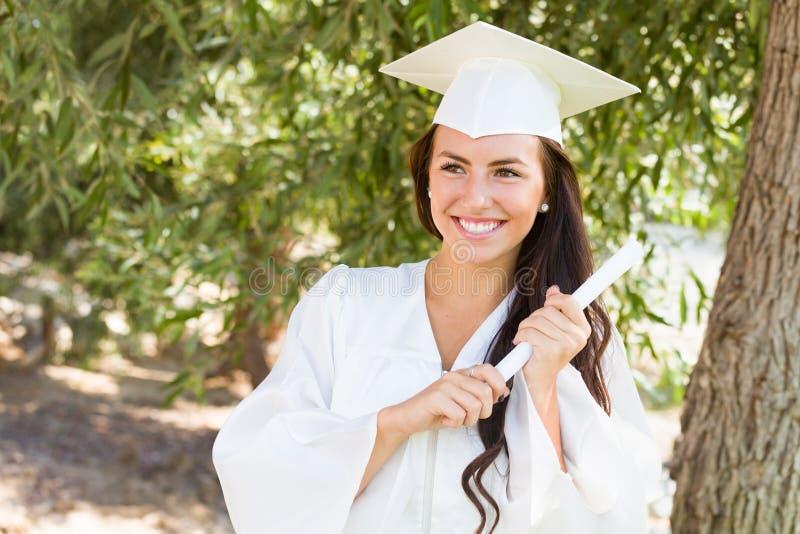 Smiling Mixed Race Teen Girl at Graduation Holding Diploma stock photography