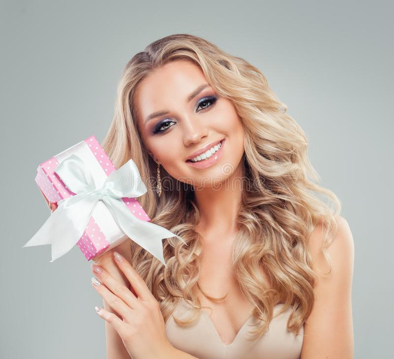 Smiling Model Woman with Long Healthy Hair with Pink Gift Box royalty free stock photos