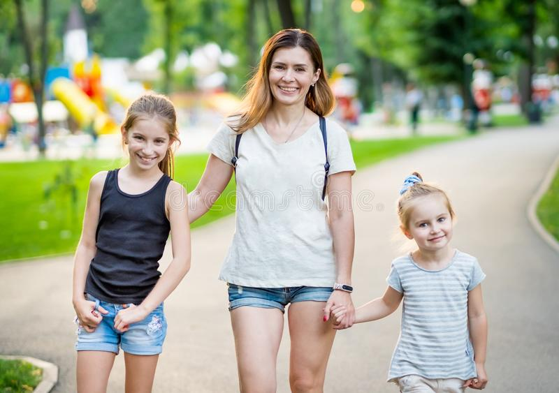 Smiling mom with little daughters royalty free stock images