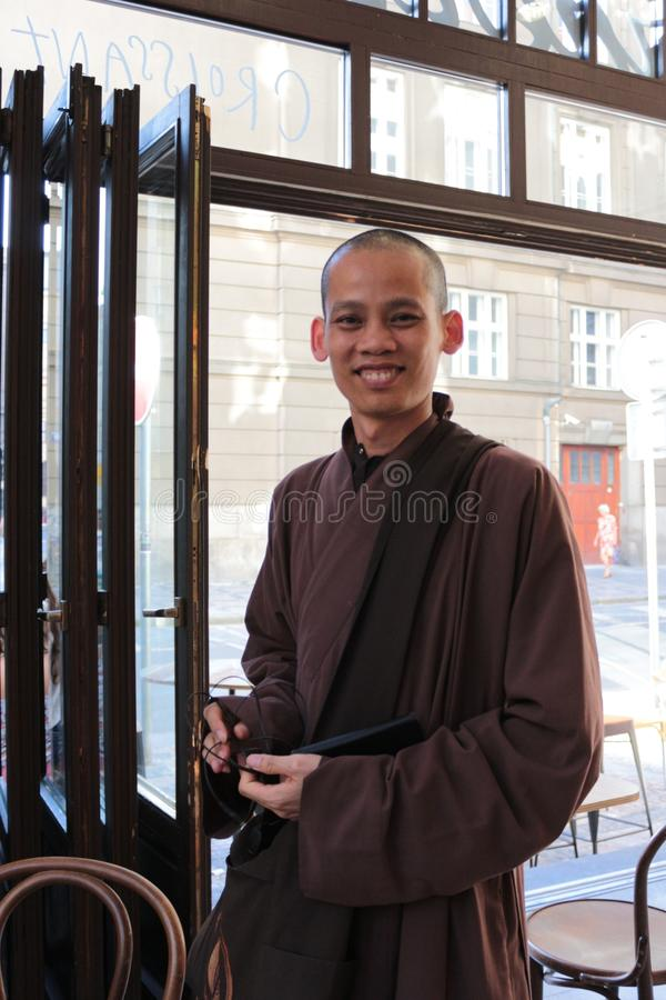 Free Smiling Monk In A Restaurant In Prague. Royalty Free Stock Images - 108796679