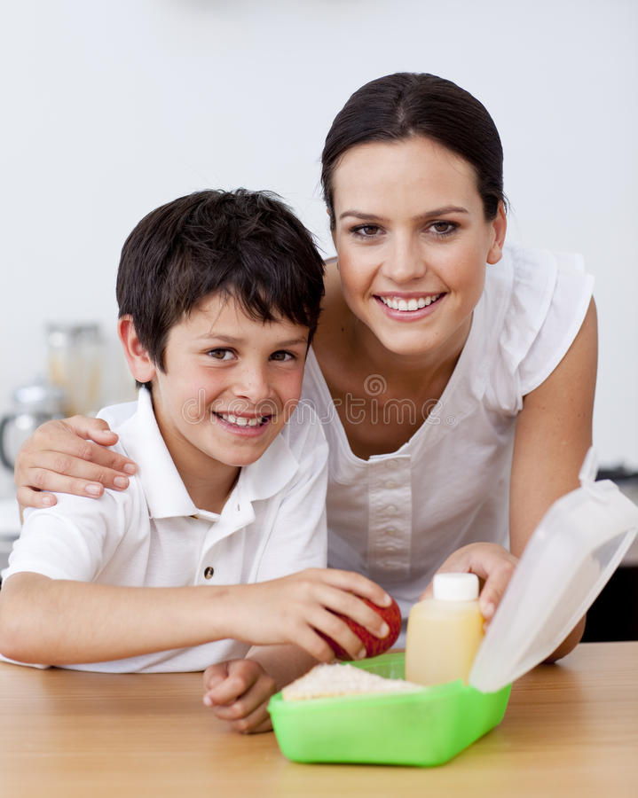 Free Smiling Mother And Son Making The School Lunch Royalty Free Stock Photo - 11541835