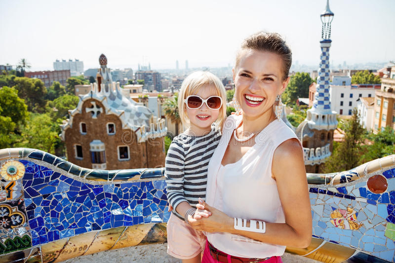 Smiling mother and baby spending fun time at Park Guell stock photography