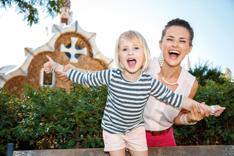 Smiling mother and child having fun time in Park Guell royalty free stock photography