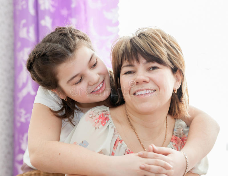 Smiling mother and daughter stock photography