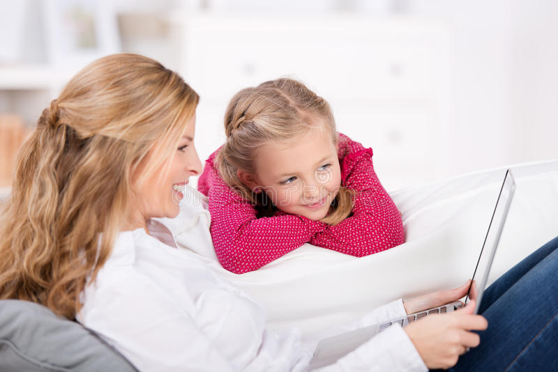 Smiling Mother And Daughter With Laptop At Home royalty free stock photography