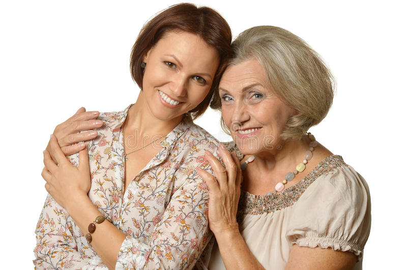 Smiling mother and daughter. Portrait of a smiling mother and daughter royalty free stock photography