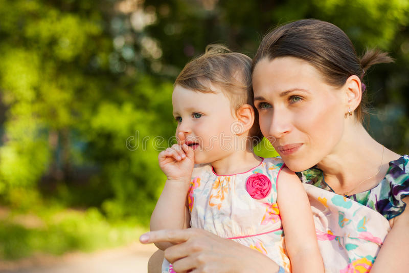Smiling Mother And Her Daughter In Summer Park. Royalty Free Stock Image