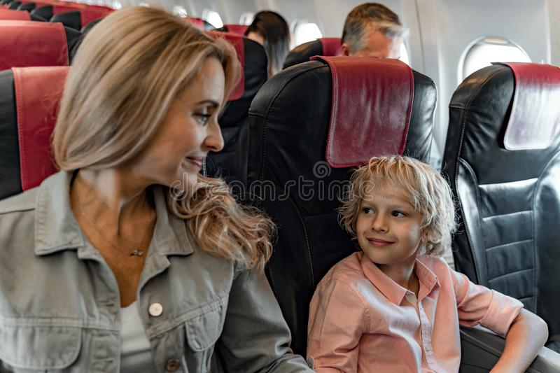 Smiling mother is looking at her son in cabin stock images