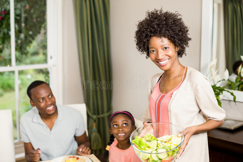 Smiling mother serving food royalty free stock image