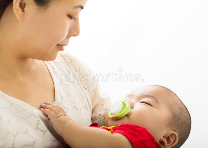 Smiling mother with sleeping baby. Boy royalty free stock image