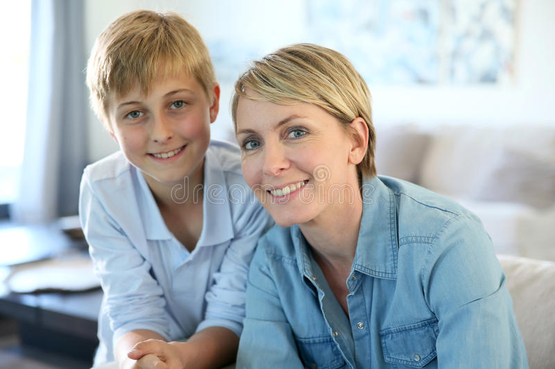 Smiling mother and son at home stock photography